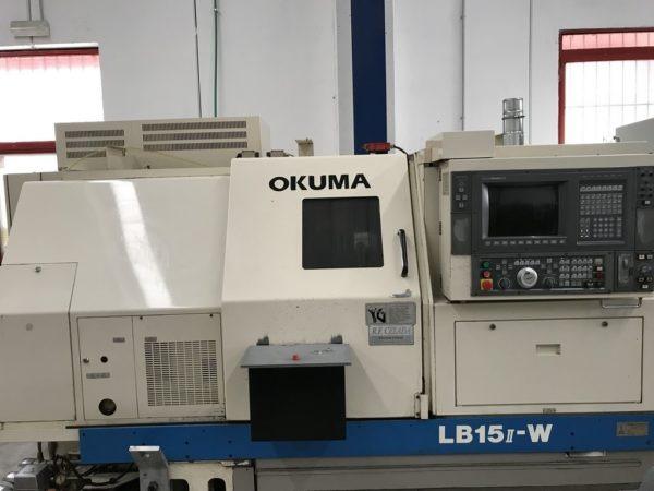 Tornio cnc OKUMA LB15II W contromandrino con caricatore di barre LNS usato